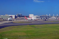 Sydney Airport - QF maintenance base on the left, and QF domestic terminal on the right - by Micha Lueck