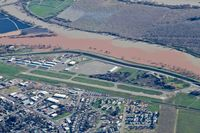 Yuba County Airport (MYV) - Overhead Yuba County Airport enroute to Oroville Municipal Airport. Note the fill river abeam the airport. This was taken when Lake Oroville was over capacity and had the dam situation. In fact, mandatory evacuations were made the same day I took this pic - by Chris Leipelt