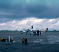 London Southend Airport - Light aircraft park , C. 1977, Southend Airport - by Paul Howlen