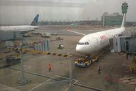 Hong Kong International Airport - Dragonair flight arriving at Hong Kong Intl'l - by Bob Simmermon