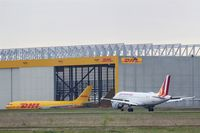Leipzig/Halle Airport, Leipzig/Halle Germany (EDDP) - Inbound traffic on rwy 08R passes DHL parcel freighter ..... - by Holger Zengler