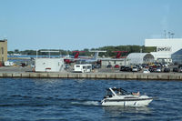 Toronto City Centre Airport - A view on the parking, from the ferry - by olivier Cortot