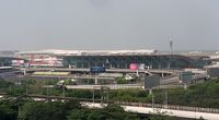 Shenzhen Bao'an International Airport - Shenzhen Airport view from hotel over the 'old' terminal. - by FerryPNL