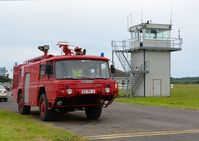 Pembrey Airport - Former Royal Navy fire and rescue tender 'Fire 2' by the airport's control tower  - by Roger Winser