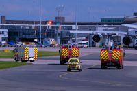 Manchester Airport, Manchester, England United Kingdom (EGCC) - fire trucks following G-JECY bee  - by andysantini