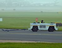 Manchester Airport, Manchester, England United Kingdom (EGCC) - FBO tug going to get [D-BUZZ CE750] and tow it over to the [FBO exc ramp] at egcc uk. - by andysantini