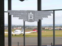 Archerfield Airport - DCA (Department of Civil Aviation) etched on the window of the waiting lounge - Archerfield Qld - by Arthur Scarf