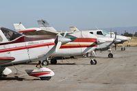 South County Arpt Of Santa Clara County Airport (E16) - Row of rotting aircraft at San Martin Airport, CA. - by Chris Leipelt