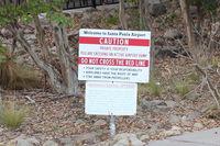 Santa Paula Airport (SZP) - Pedestrian Warning Sign-near CP Aviation Airport entry - by Doug Robertson