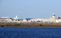 Naha Airport - Naha International Airport is Okinawa's main commercial airport. The airport is also home to Naha AB of JASDF. Nice traffic mix of commercial & military aircrafts. - by Jean M Braun