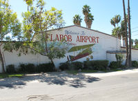 Flabob Airport (RIR) - Nice paintjob on the wall - by olivier Cortot