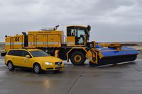 Boise Air Terminal/gowen Fld Airport (BOI) - The Volvo friction tester beside a new sweeper/blower combo in one truck. - by Gerald Howard