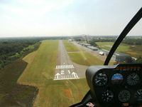 Zwartberg Airport - Landing with R44 00-AAR @ EBZW - by Guy Vandersteen