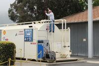 Santa Paula Airport (SZP) - Pete on the Santa Paula SHELL 100LL Fuel Tank. He drains the sump daily for any condensation H2O. - by Doug Robertson