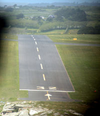St. Mary's Airport - Short finals for 32 St Marys Isles of Scilly in Twin Otter G-CEWM.  Since my 1987 pictures (qv) the grass has been replaced by tarmac runway.  The slope here is quite apparent, see also the shots at ground level from the threshold. - by Pete Hughes