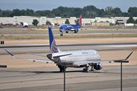 Boise Air Terminal/gowen Fld Airport (BOI) - United Express taxies out for RWY 10L while Sun Country takes off on RWY 10R. - by Gerald Howard