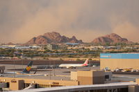 Phoenix Sky Harbor International Airport (PHX) - A big dust storm is approaching PHX from the east. - by Dave Turpie