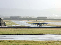 RAF Lossiemouth - The sunshine after the rain - A Tornado GR4 is towed across the airfield - by Clive Pattle