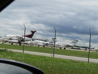 Austin Straubel International Airport (GRB) - crowded apron from side road - by magnaman