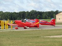 Wautoma Municipal Airport (Y50) - nice pair of reds at Wautoma. Nearest to camera a mystery aircraft! If you know the N number please e-mail me!!! - by magnaman