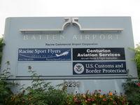 John H Batten Airport (RAC) - sign at entry to car aprk - by magnaman