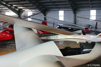 Lasham Airfield Airport, Basingstoke, England United Kingdom (EGHL) - Crowded hangar @ Lasham, Hants. - by Clive Pattle