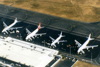 Brisbane International Airport - APOV of 'Old Eagle Farm' International Airport YBBN on 12Aug1992. The line-up on the ramp (from front right to left) is a JAL Super Resort Express B747-246B, an Air New Zealand B767, a Qantas B747-338, and a British Airways B747-436.  - by Walnaus47